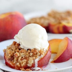 Peaches stuffed with streusel and topped with ice cream.