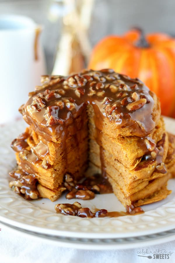 Stack of pumpkin pancakes with pecan syrup.