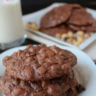 Chocolate cookies on a white plate.