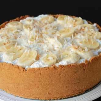Deep dish pie topped with banana and coconut.