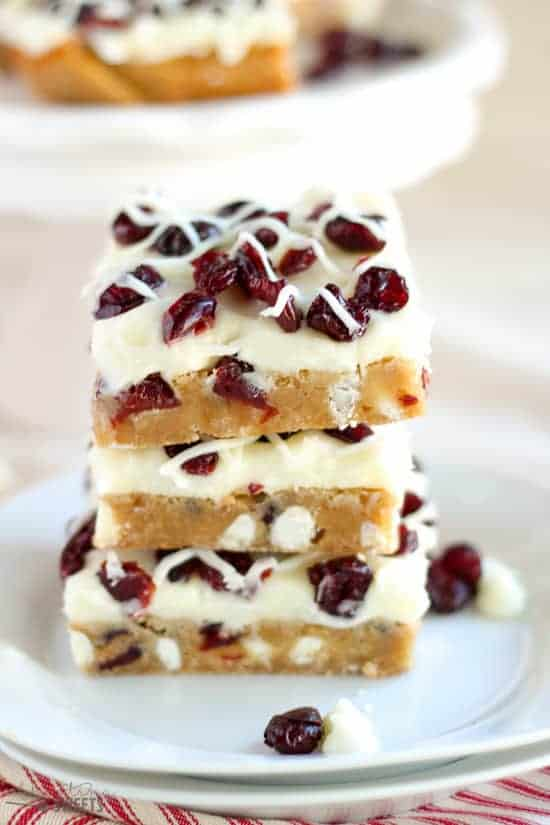 Stack of Three Blondie Dessert Bars with White Chocolate Chips and Cranberries