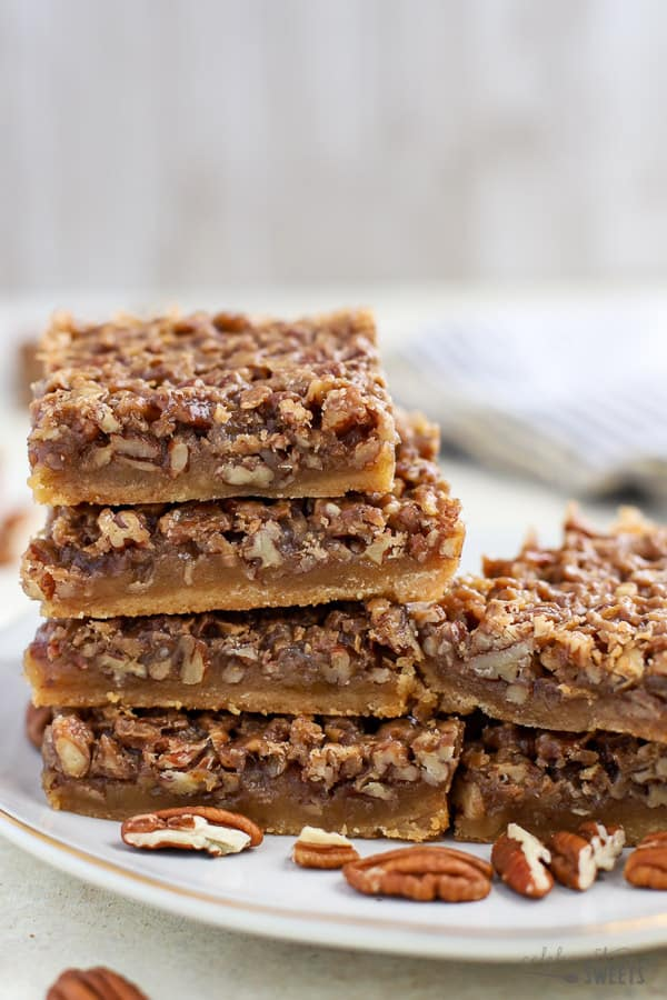 Maple Pecan Pie Bars on a white plate.