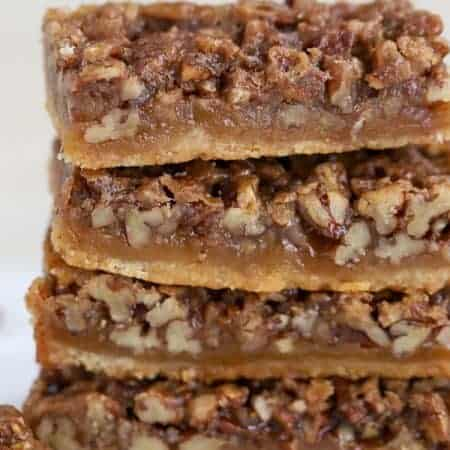 Maple Pecan Pie Bars on a white background