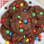 Chocolate M&M Cookies on a white plate.
