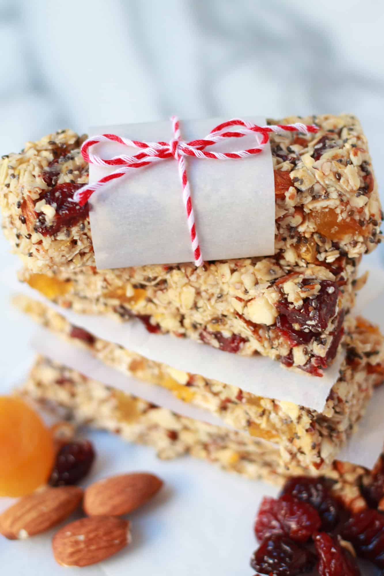 Stack of granola bars on pieces of parchment paper.