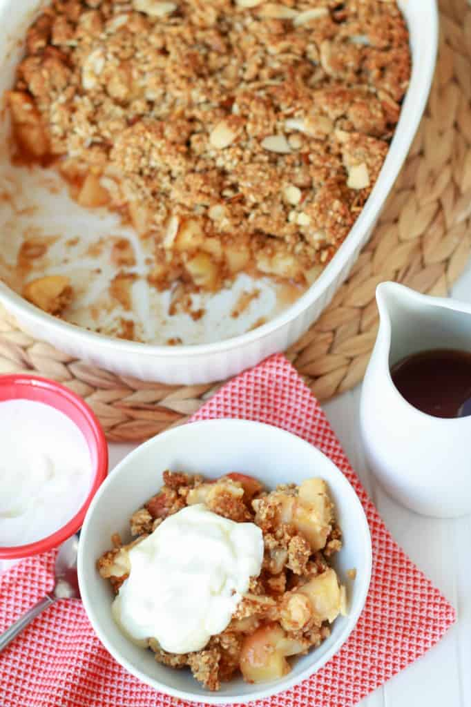 apple breakfast crisp in a bowl with yogurt