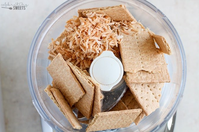 Graham crackers and coconut in a food processor.