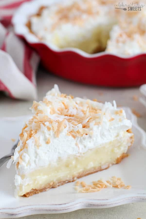 Coconut Cream Pie on a white plate.