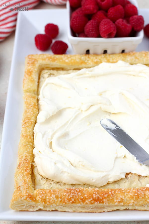 Lemon Cream Cheese Filling being spread into a Puff Pastry crust.
