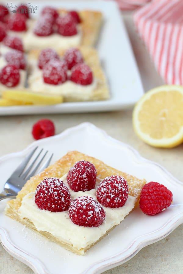 Slice of a Lemon Tart topped with Raspberries.
