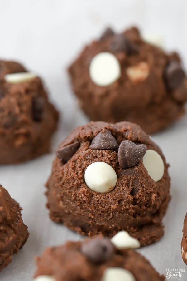Chocolate cookie dough ball topped with chocolate chips.