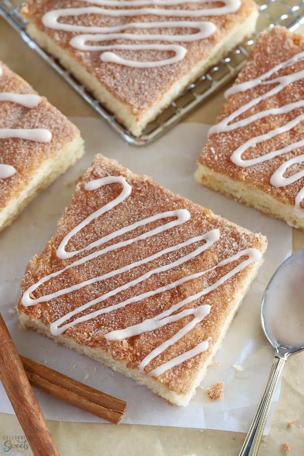 Cookie bar topped with cinnamon sugar and drizzled with white icing.