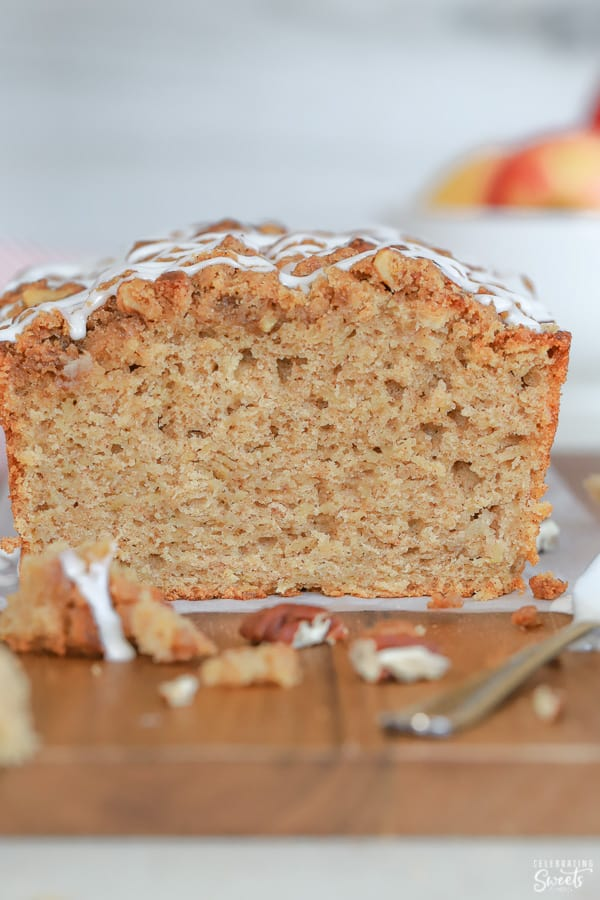 Loaf of Apple Bread topped with icing.