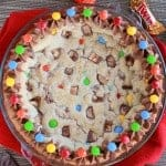 Cookie cake topped with M&M's candies and chocolate frosting.