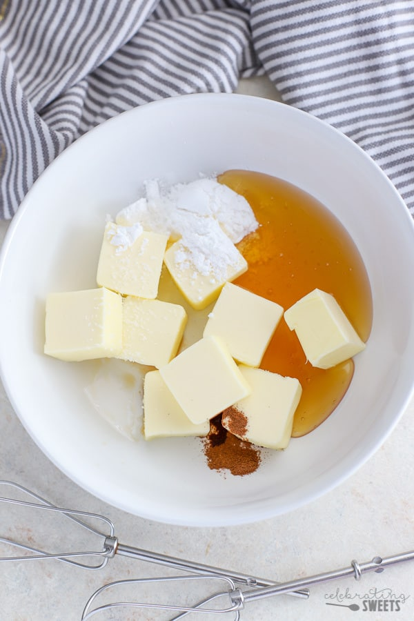Ingredients for Honey Butter in a white bowl.