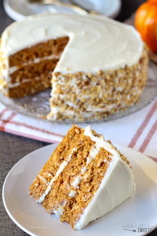Three layer carrot cake on a white plate.