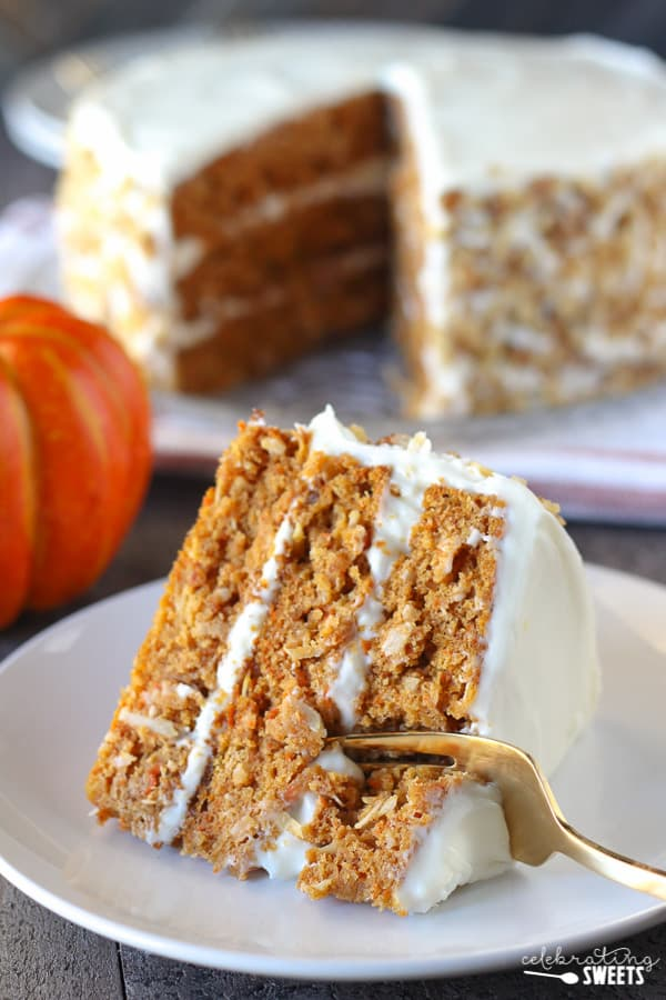 A piece of pumpkin carrot cake on a white plate.