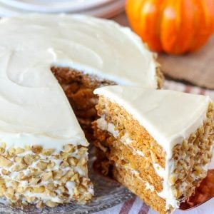 Close up of three layer carrot cake with white frosting.