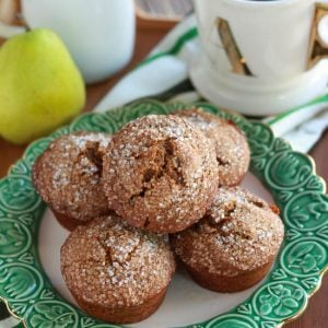 Gingerbread muffins on a white and green plate.
