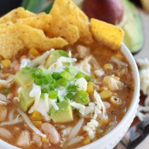 Bowl of chicken chili with tortilla chips.