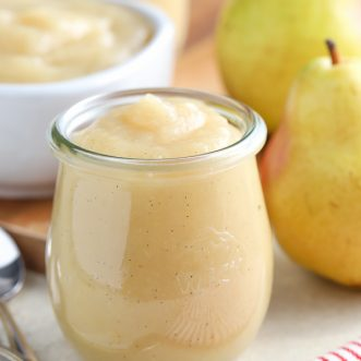 Pear sauce in a glass jar.