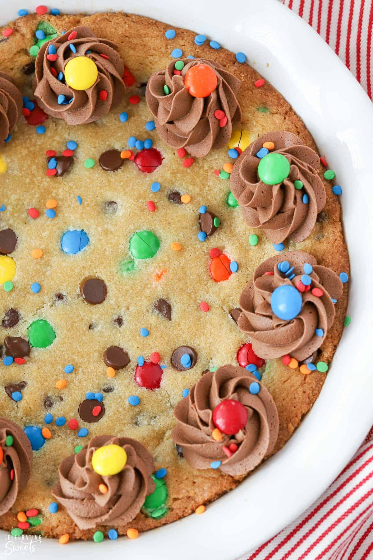 Cookie cake decorated with chocolate frosting and M&M's