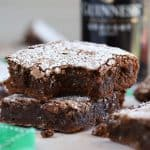 Two Guinness Brownies topped with powdered sugar.