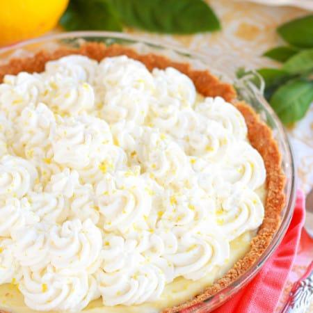 Lemon Cream Pie - Tart, sweet and super creamy. The perfect lemon pie.