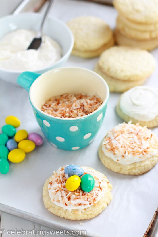 Birds Nest Cookies with a cup of toasted coconut and a bowl of vanilla frosting.