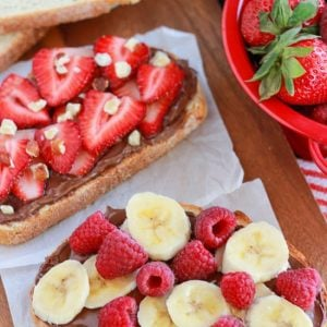 Bread topped with chocolate spread and fresh fruit.