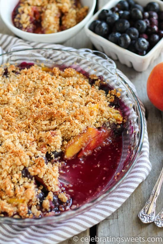 Blueberry peach crisp in a glass baking dish.