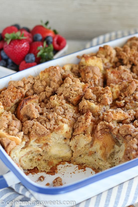 Baked French Toast Casserole with a bowl of fresh berries.