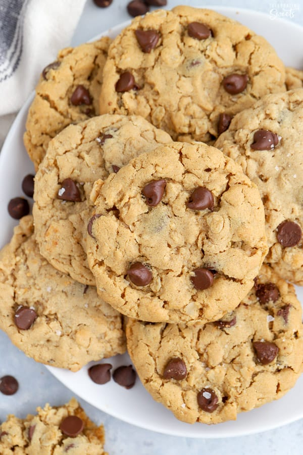 White plate filled with Peanut Butter Oatmeal Chocolate Chip cookies.