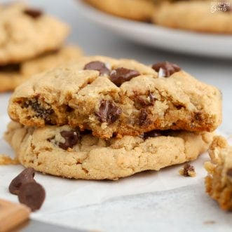 Two Peanut Butter Oatmeal Cookies with chocolate chips.
