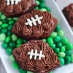 Football shaped brownies on top of green M&M's.