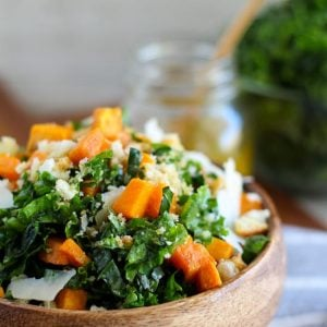 Kale and sweet potato salad in a wooden bowl.