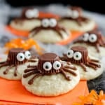 Spider Cookies- Sugar cookies decorated with chocolate frosting and mini peanut butter cups to look like spiders. An easy dessert for Halloween!