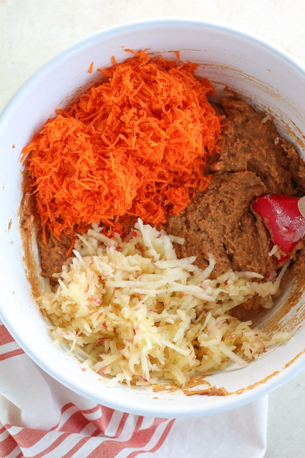 Shredded carrots and grated apples in pumpkin muffin batter.
