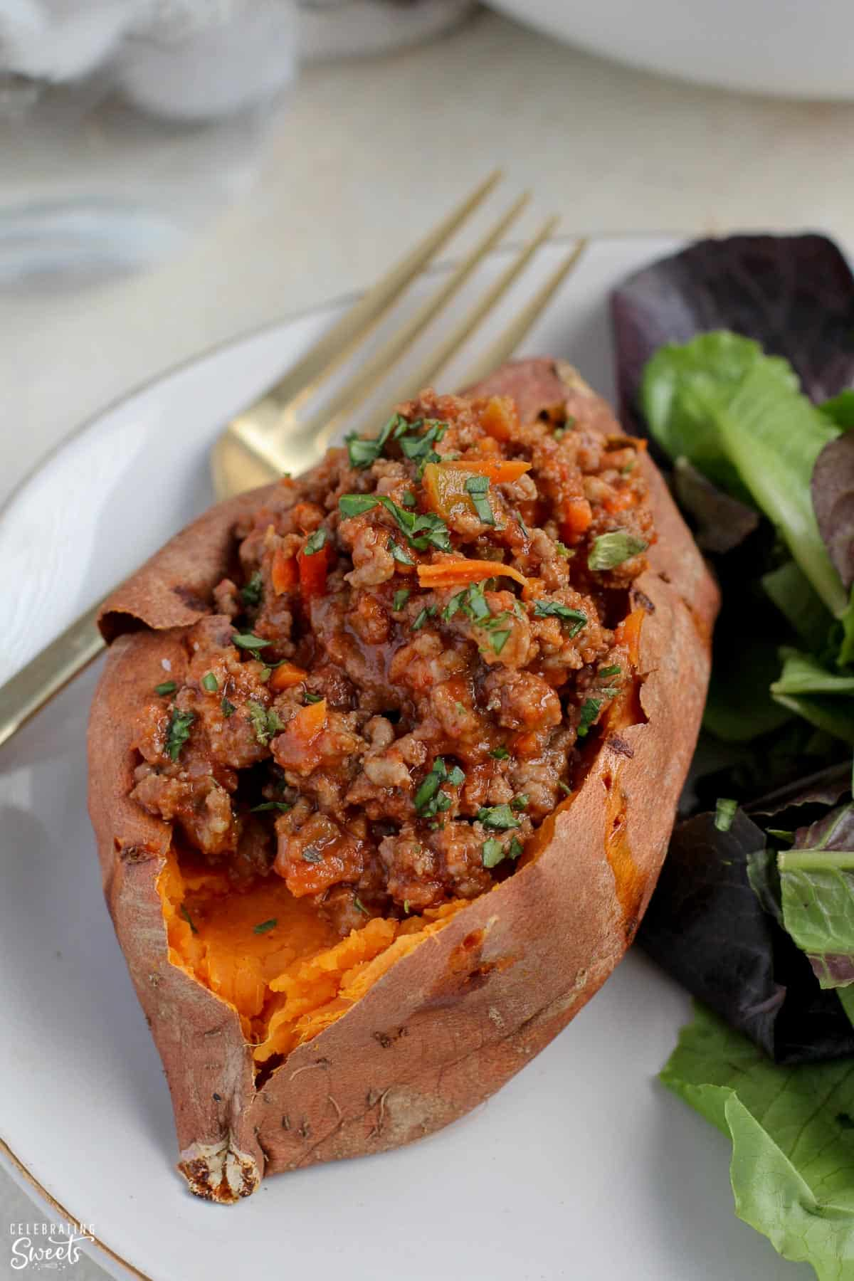 Baked sweet potato stuffed with sloppy joe meat