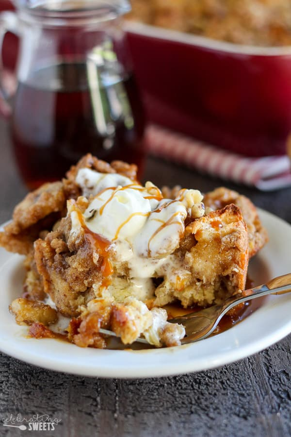 French toast casserole on a plate topped with whipped cream.