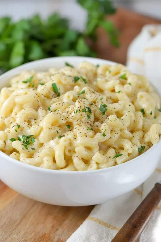 Bowl of macaroni and cheese in a white bowl.