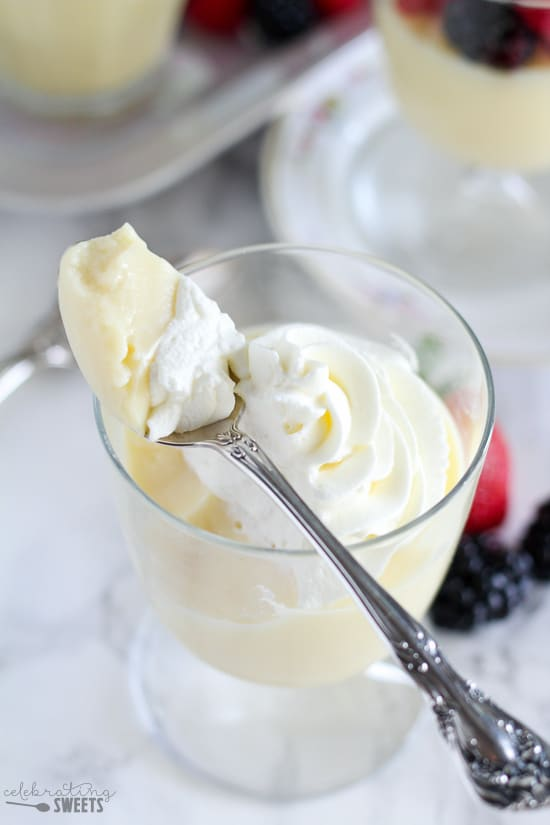 Vanilla pudding in a bowl topped with whipped cream.