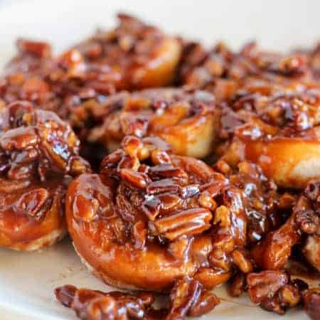 Easy 30 Minute Caramel Pecan Sticky Buns ~ Tender and gooey melt-in-your-mouth sticky buns topped with caramel sauce and chopped pecans. This easy recipe uses canned crescent roll dough and prepared caramel sauce.