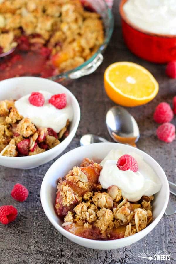 Healthier Raspberry Peach Breakfast Crisp - This healthier fruit crisp is filled with raspberries and peaches and topped with a gluten free almond-oat crumble. Serve warm or chilled for breakfast or dessert.