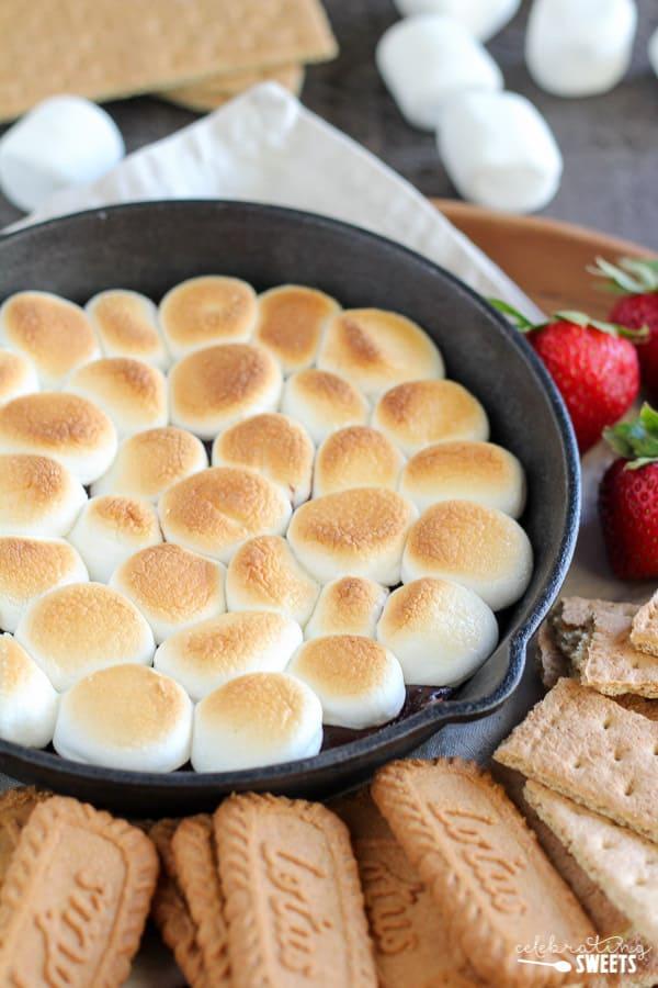 Skillet s\'mores dip topped with toasted marshmallows.