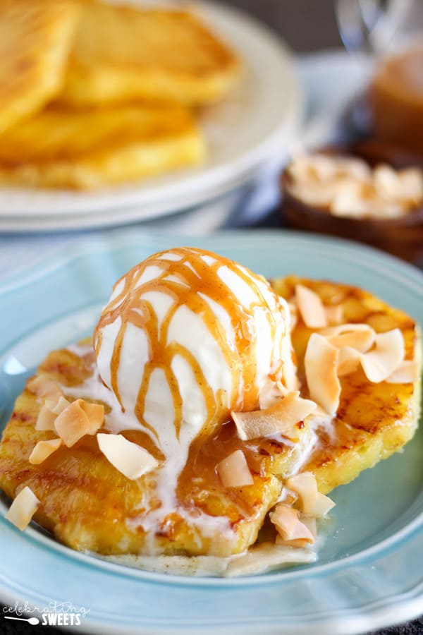 Grilled Pineapple Coconut Sundaes drizzled with Caramel Sauce and topped with Coconut Shavings