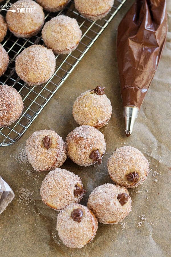 Donut holes filled with chocolate sauce coated in sugar.