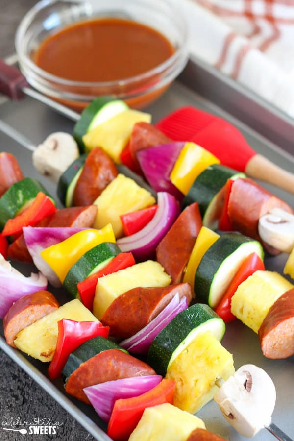 Sausage and Vegetable Shish Kebabs with a Bowl of BBQ Sauce