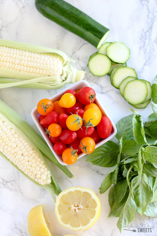 Corn, tomatoes, zucchini, basil and lemon.