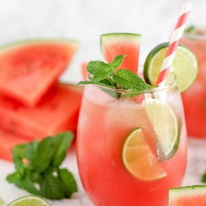 Watermelon mojito garnished with lime and mint.